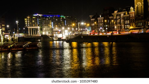 The busy Amsterdam street with light at night.