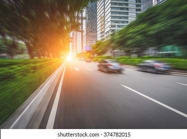 busy asphalt road in modern city under twilight