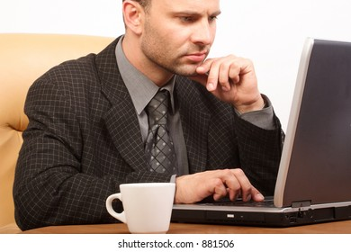 Busy boss with his laptop - close up