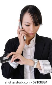 Busy business woman holding cellphones and watching watch, closeup portrait on white background.