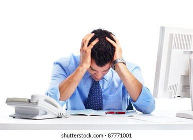Busy businessman having stress and headache at office.