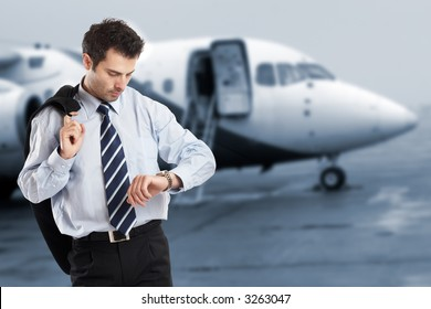 Busy businessman with jacket on his shoulder looking at his watch on the airport - check my portfolio for similar photos