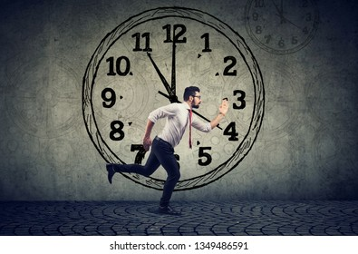 Busy businessman running on time feeling determined