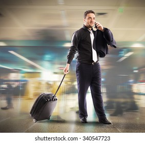 Busy businessman talking on cellphone in airport