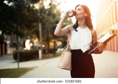 Busy businesswoman in rush  outdoors