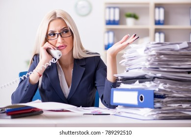 Busy businesswoman working in office at desk