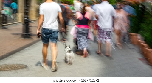 Busy city people going along the street. Intentional motion blur. Defocused image