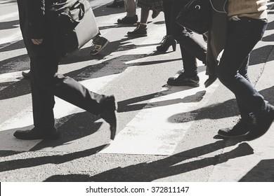 Busy city people on zebra crossing street,vintage filter.