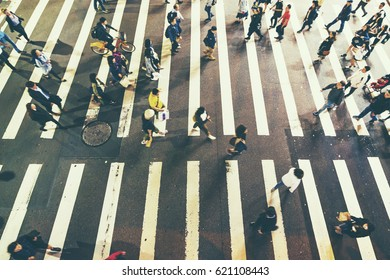 Busy city people on zebra crossing street