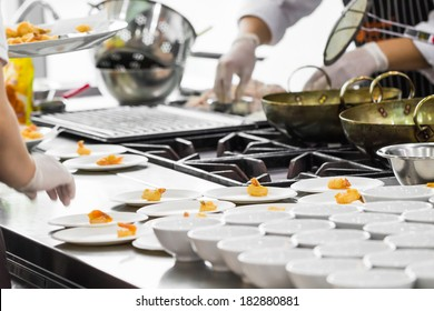 Busy cooking of chefs in restaurant kitchen