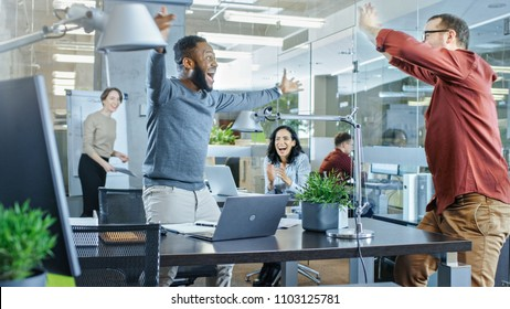 Busy Corporate Office, Man Met Old Friend and Jumping with Happiness, Gives High-Five to His Friend. Everybody is Happy.