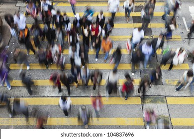 Busy Crossing Street in Hong Kong, China.