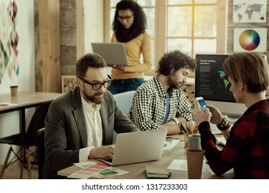 Busy day. Group of businesspeople looking involved while working in the office