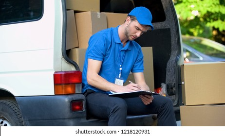 Busy delivery workman counting parcels, stocktaking checklist, part-time job