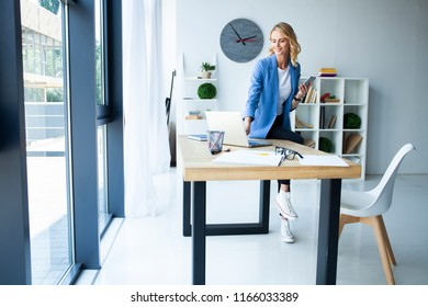 Busy employer. Beautiful business lady smiling while working in office