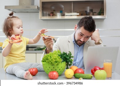 Busy father and his child have fun during lunch