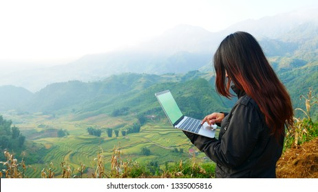 Busy freelance woman laptop outdoor.  Businesswoman corporate city life outside with lifestyle technology. Beautiful woman connect internet outdoor on the beach. Internet technology lifestyle concept.