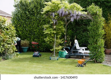 Busy in the garden with a mower aerator and a lawn spreader