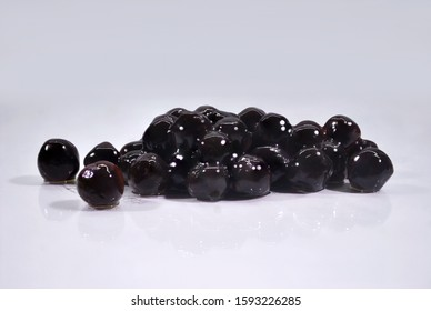 The busy grain is made from flour, added to cold drinks. Thai people call it black pearls isolated on white background.(with Clipping Path).