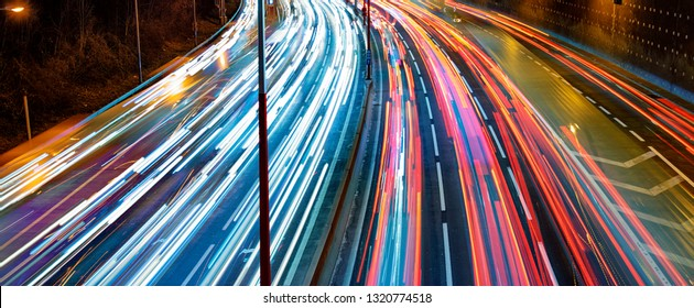 busy highway traffic at nigh in  the city