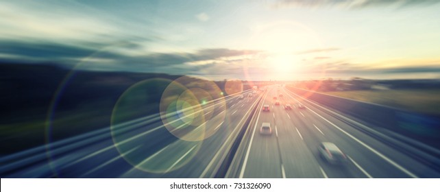 busy highway traffic at sunset time