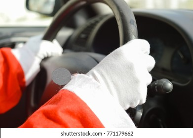 Busy holiday time for Santa Claus driving vehicle carrying delivering presents for celebrating happiness. Close up on person providing quick transportation service. Rushing people solution concept.
