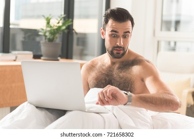 Busy male worker is late for deadlines
