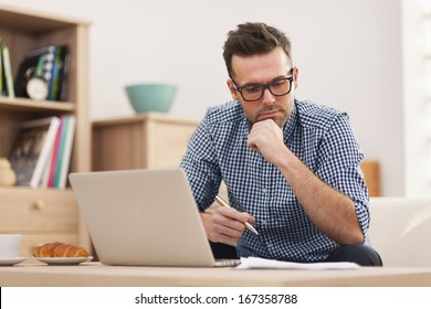 Busy man working at home
