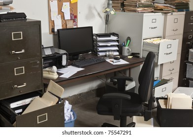 Busy, messy, cluttered, funky office space.