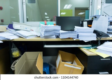 Busy, messy and cluttered workplace, full of documents