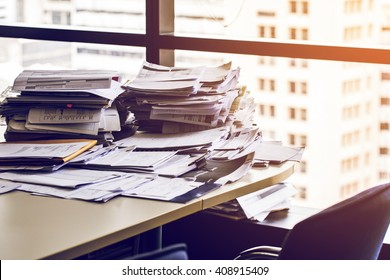 busy office with stack document on table.