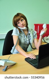 busy office woman talking by three phones