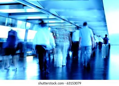 busy people in blurred motion on footbridge