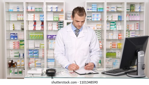 Busy Pharmacist Man Writing on Clipboard Taking a List of Medicine Pills in Pharmacy Shop
