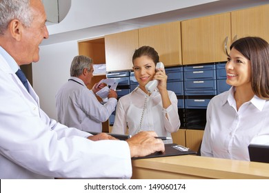 Busy reception in a hospital with doctors and receptionists