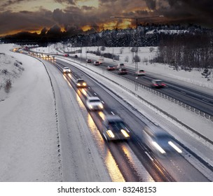Busy road in winter evening
