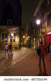 The busy sidewalks and pedstrian zones in the Red Light District by night  - AMSTERDAM / THE NETHERLANDS - JULY 19, 2017