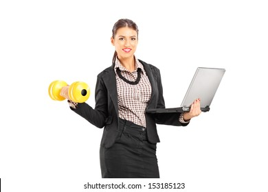Busy smiling businesswoman holding a laptop and lifting a dumbbell isolated on white background