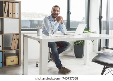 Busy smiling man in office