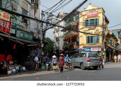 Busy street corner in old town Hanoi Vietnam.December 23, 2019 Busy street corner in old town Hanoi Vietnam. Most vehicles on the roads of Vietnam are motorcycles and scooters.