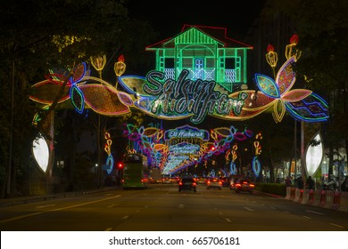 Busy street lightened up with colorful decorative lightings with people shopping walking on both sides during Ramadan holy month of Muslim Eid Mubarak Salam Aidilfitri Hari Raya  festival in Singapore