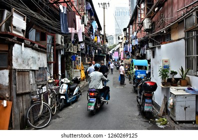 Busy streets in old city center of Shanghai. China.  Historical part of Shanghai - popular destination for locals ind tourists. Photo taken 2018-05-28.