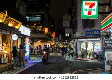 busy streets of yongkang with shops and crowds walking around. Taken at night. Taipei, Taiwan. October 23rd 2018.