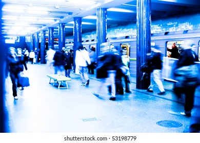A busy subway station at rush hour. Long exposure high key effect shot. Incorrect white balance