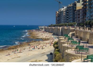 Busy summer beach at Exiles Beach, Sliema, Malta, July 2016