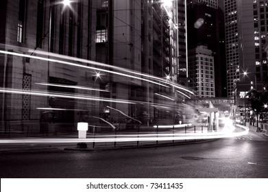Busy traffic in Hong Kong at night in black and white