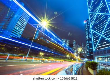 busy traffic at night in downtown Hong Kong,China.