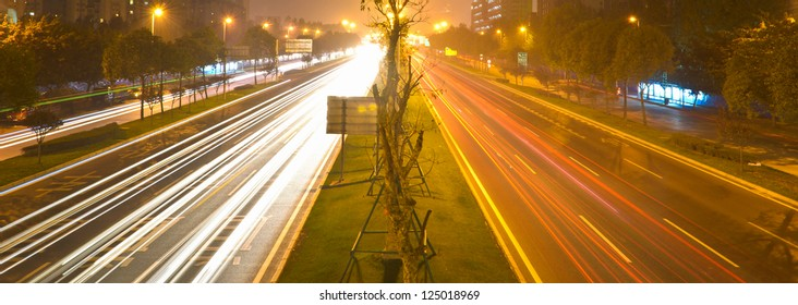 busy traffic on the road at night