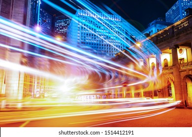 Busy traffic and urban landscape at night in Hong Kong