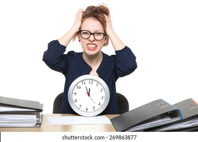 Busy Woman With Clock t The Desk